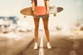 Girl holds Longboard