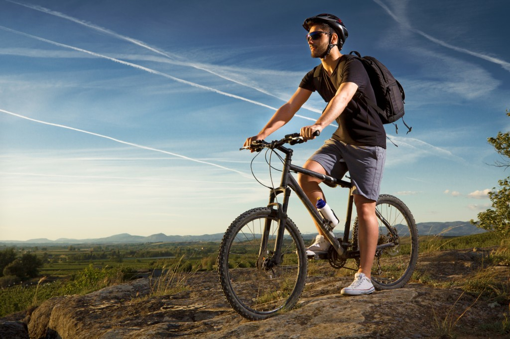 Young man riding mountain bike